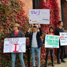UWT Students Nathan Pelland, Zak Pelland, Sam Ranslem, and Miku Jia protest SAB's partnership with Pierce County Asylum photo courtesy of Chelsea Vitone