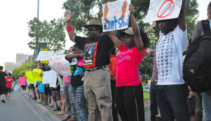 In September, members of the community gathered across the street from campus to protest the killing of Michael Brown in Ferguson, MO. Would the rules have changed if the demonstration were held on school grounds? Photo by Chelsea Vitone