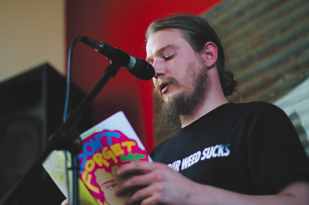 "James Nordlund reading his gritty poem ""Readership Redefined."" PHOTO BY ALLISON PHAM"