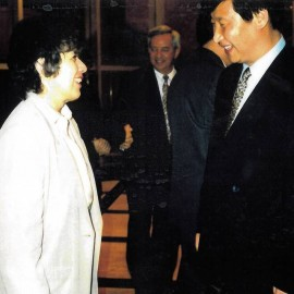 Courtesy of Connie Bacon, via the Wall Street Journal. Then Executive Director of World Trade Center Tacoma (left), talks with Mr. Xi Jinping (Right) during the future president's visit in Tacoma in 1993.