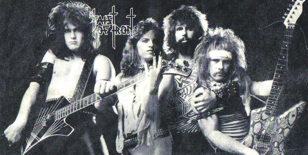 The original lineup of Taist of Iron in full '80s hair band attire.